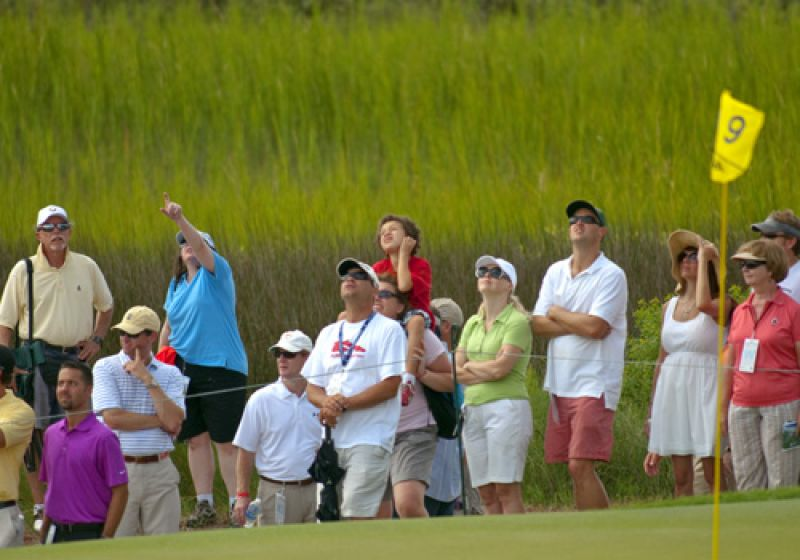 Fans on the 9th green watching an incoming approach shot.