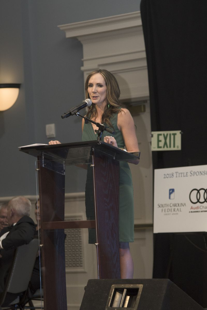Emcee and auctioneer Erin Kienzle commands the mic.