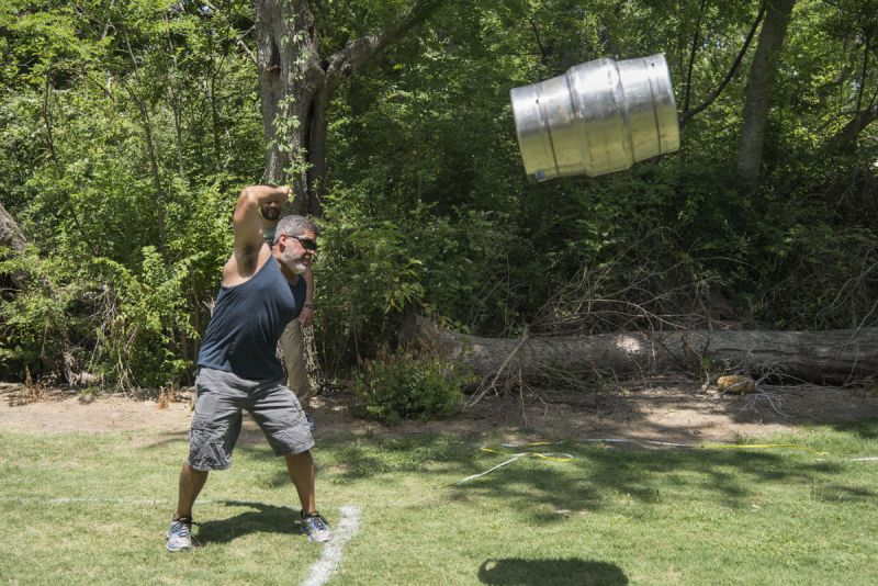 Participants tested their strength during the Kettlebell Keg toss.