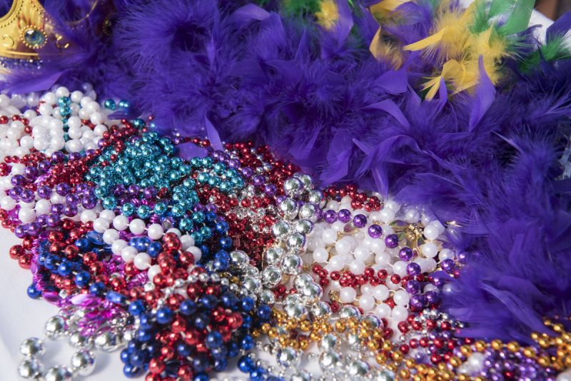 Traditional Mardi Gras beads were handed out before the crawl.