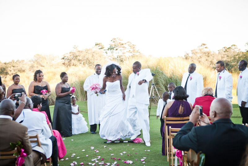 "LEAP OF FAITH: Tamars and Jaime sealed their vows with the African tradition of ""jumping the broom,"" which symbolizes sweeping away the old and welcoming the new. The couple says their ceremony was dedicated to the memories of the bride's father and the groom's grandfather."