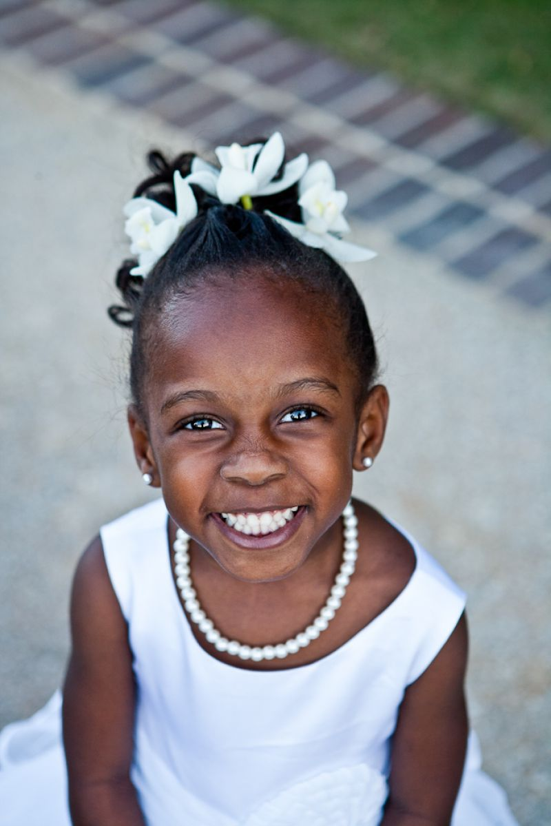 PEARLY WHITES: Flower girl Jayda, the bride's goddaughter, was all smiles in her ivory outfit complete with pearls.