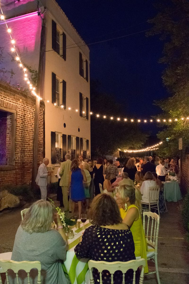 Guests socialize in Bedon's Alley, all lit up for the occasion.