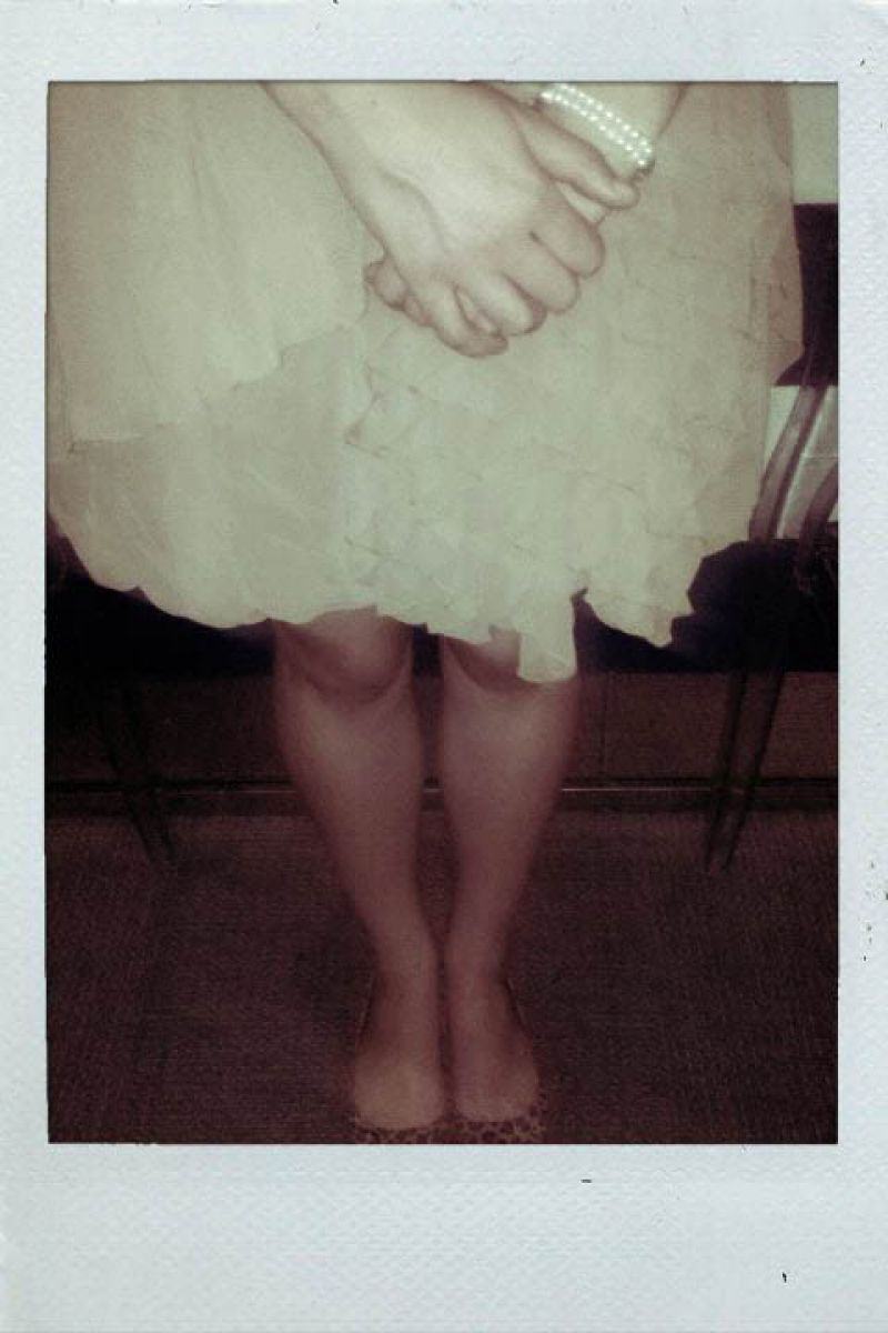 Classic pearl bracelet, ethereal layered dress, leopard flats.