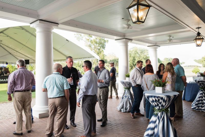 Guests mingle on the patio as the event gets started.