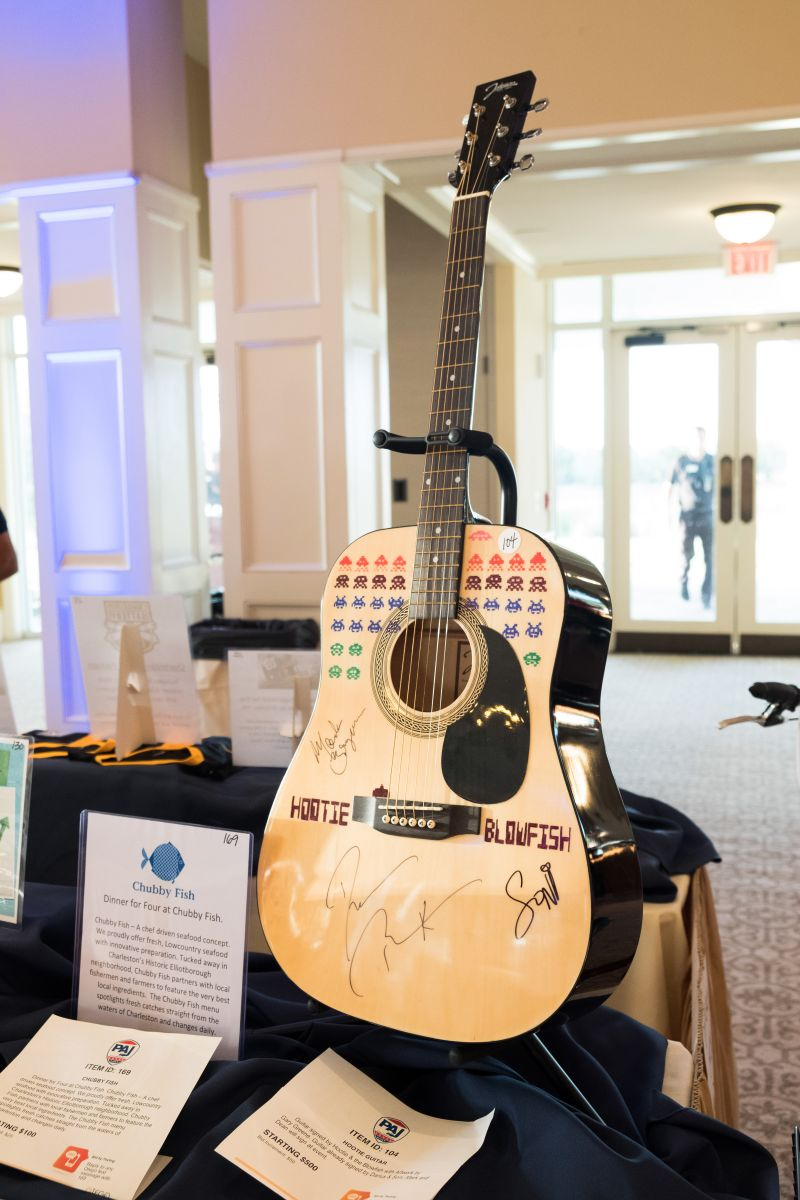 One of the silent auction items: a guitar signed by the members of Hootie and the Blowfish