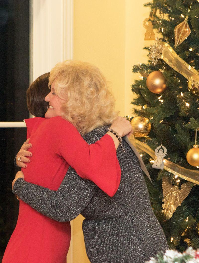 Sundi Herring and Kayleen Martin embrace after her touching speech.