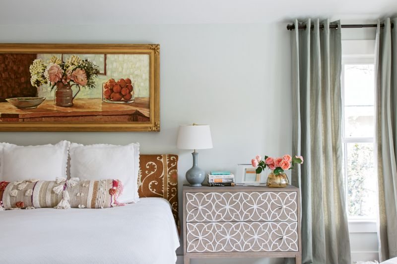 In the master suite, a Russian impressionist still life complements the Suzani embroidered headboard.