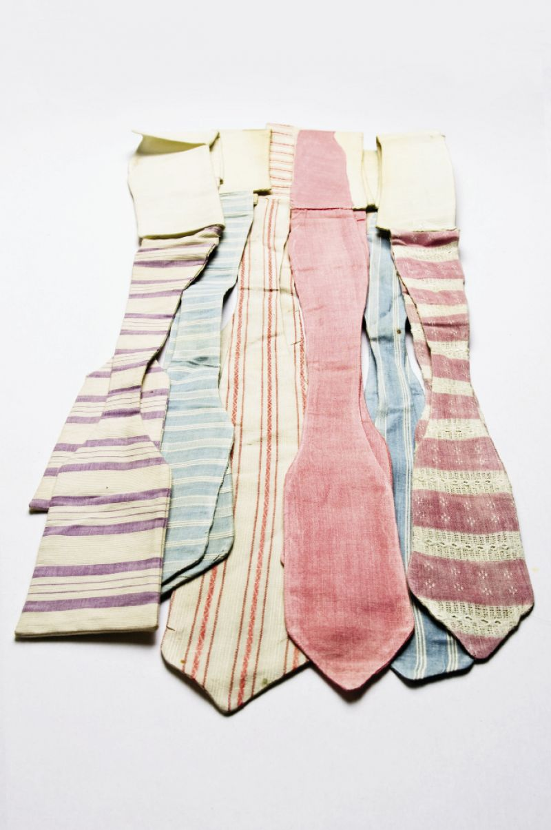 "IN THE PINK All of these cotton ties hail from the early 1900s. ""Wouldn't they be perfect with a straw boater on a summer afternoon?"" asks The Charleston Museum's curator of textiles, Jan Hiester."