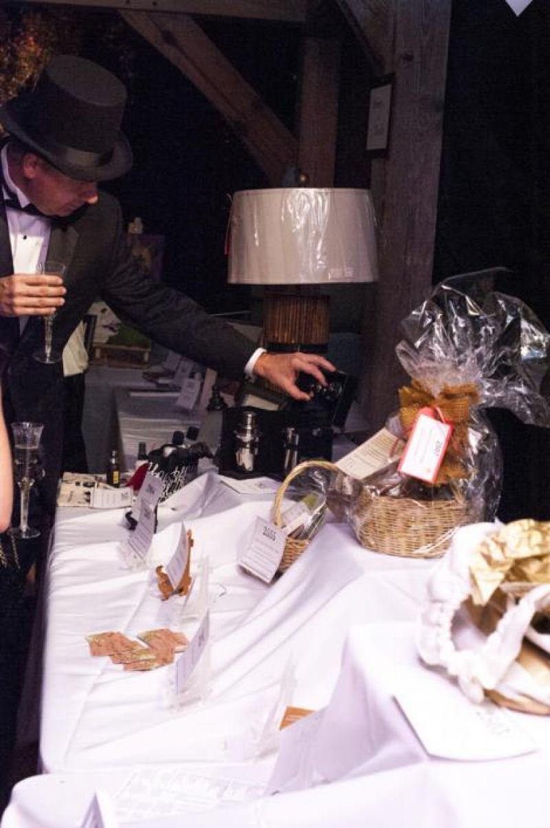 Partygoers browse more than 70 silent auction items
