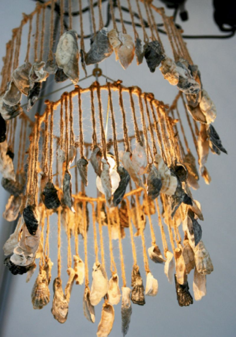 Katherine Miller and the crew at Atlantic Tent Rental strung oyster shells with twine and hung them from a chandelier frame for a touch of rustic—and relevant—elegance.