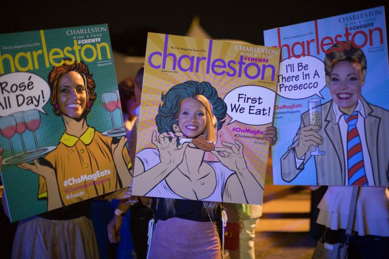 Party-goers smile for a photo with Charleston magazine's pop art covers.