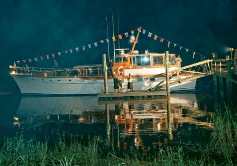 The couple's getaway transport—a 1963 Trumpy yacht, the Blue Moon—doubled as their wedding night digs.