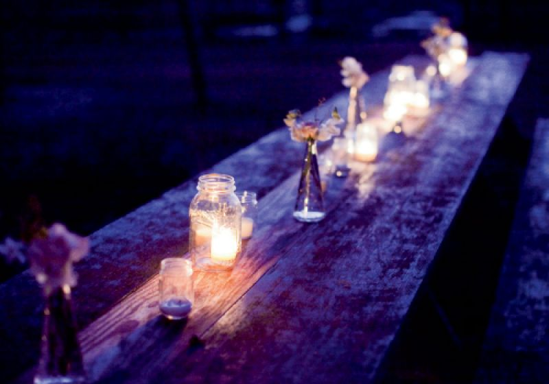 Light The Way: Mason jars with votives tossed a soft glow and protected the barn from open flames.