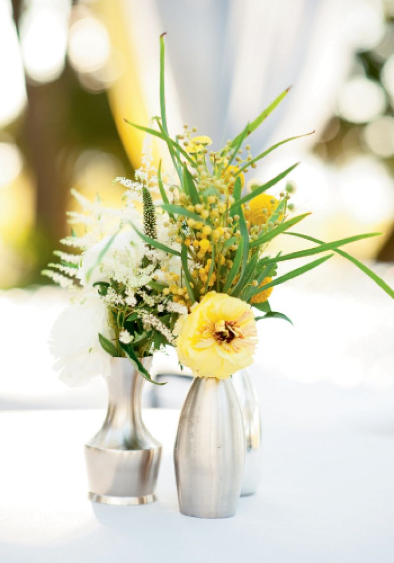 Wild Abandon: Wispy acacia and humble Astilbe toned down the formality of standout blooms, like this yellow lisianthus.
