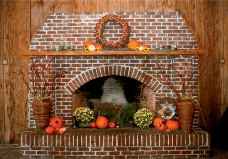HAVE A HEARTH: Inexpensive—but colorful—fall trappings like mums, pumpkins, and vines suited the rustic look of the location.