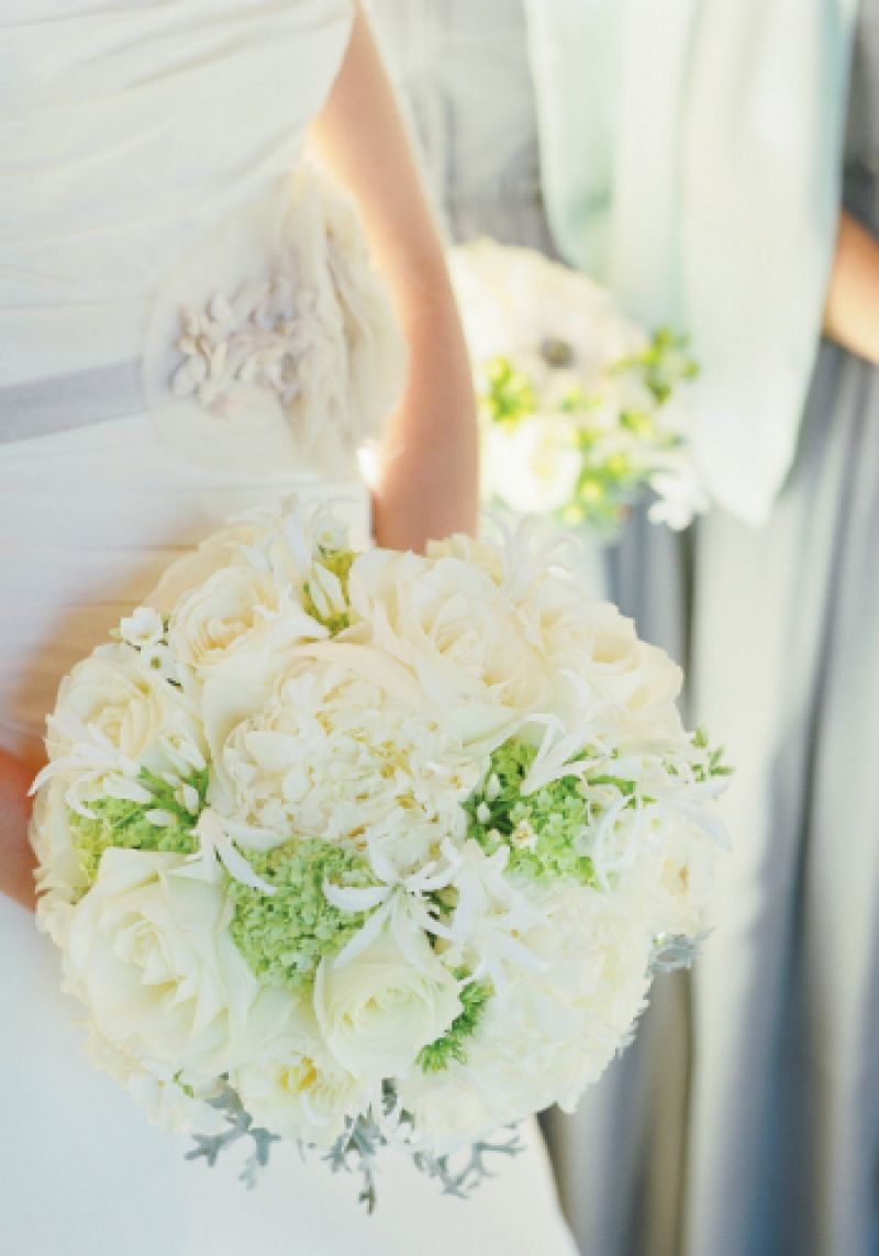 LESSONS IN SUBTLETY: Silvery gray appeared on the bride's sash, in her bouquet, and on her bridesmaids' gowns.