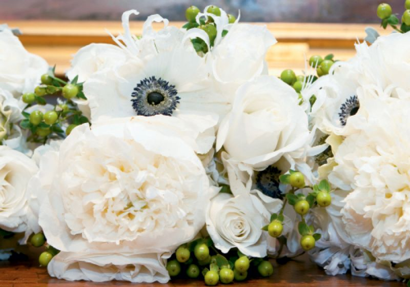 FLORABUNDANCE: Kimberly devoted most of her budget to standout blooms like these white anemone, hypericum, and roses.