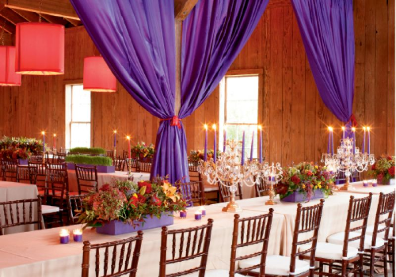 GLITZ & GLAMOUR: Long tables created an at-home feeling amidst the extravagant décor and lush setting, resplendent with flower boxes that spilled forth Asiatic lilies, cabbage roses, hydrangeas, and hypericum berries.