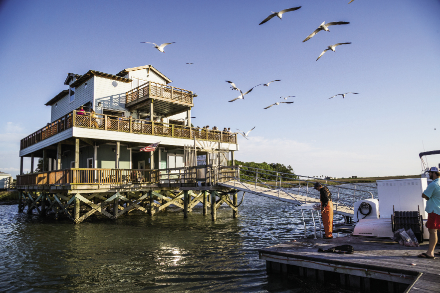 Sunset Cay  Yacht Club: At the south end of Folly, turn right onto 9th Street and follow the paved road to the end. Upstairs from the marina, you'll find this casual hangout with fried seafood and cheap beers set against the backdrop of the Intracoastal Waterway. 66 W. 9th St. Ext.  Monday-Friday: 4-9 p.m., Saturday-Sunday: Noon-9 p.m. (843) 588-0001 Note: Membership requires $5 in dues and a 24-hour waiting period.
