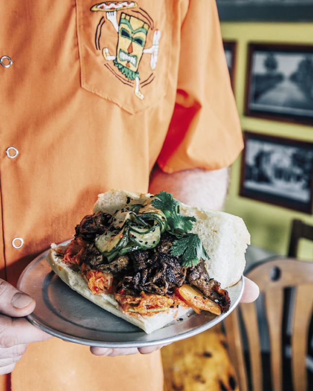 The Korean BBQ sandwich is piled high with Bulgogi-style beef with kimchee and quick-pickled cucumber.