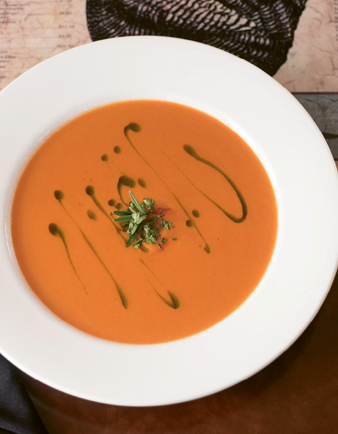 Bowled Over: Fresh rosemary sprigs, handpicked from Goulet's backyard garden, top off tomato soup.