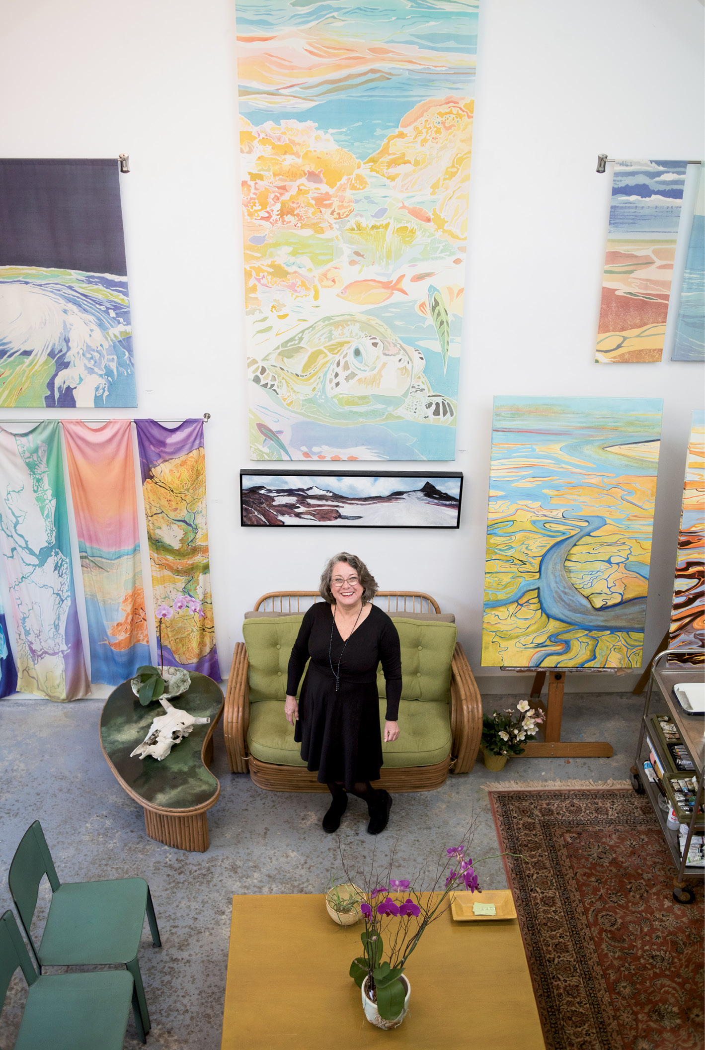 """Looking Up: Fraser (photographed in her studio) brings an aerial perspective to her works, giving viewers a broader understanding of how human actions impact the landscape. """"I go where I feel I'm most needed,"""" she says, in choosing her subject matter."""