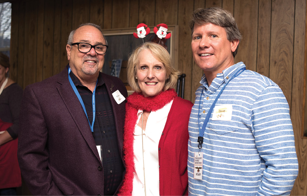 Feed the Need's Mickey Bakst with Tricounty Family Ministries interim COO Sue Hanshaw and board member David Yarborough at the shelter's holiday lunch