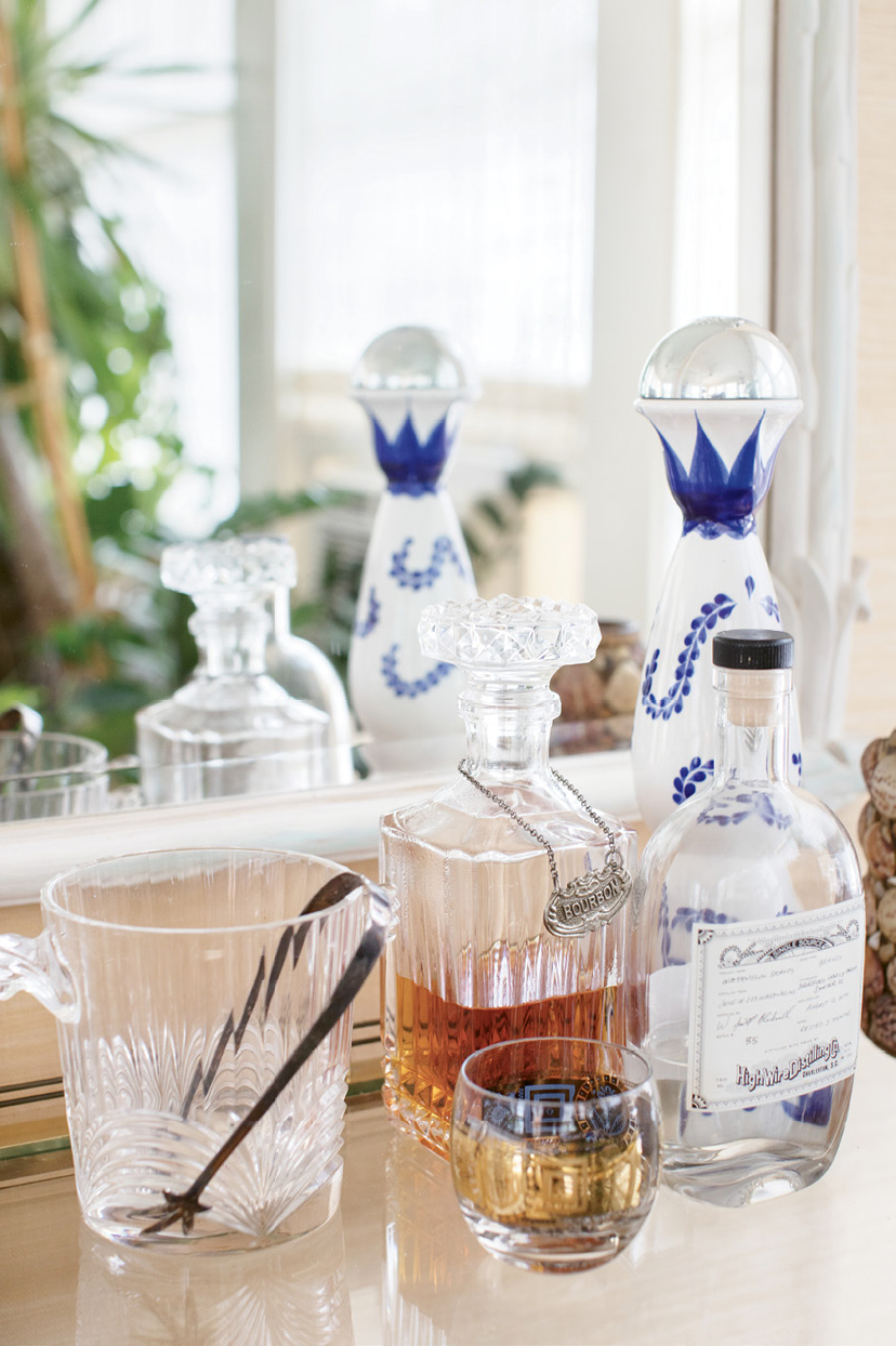 Cocktails and conversation flow in the welcoming home of Dr. Melvin and Deborah Brown. He's known for his cooking and mixology skills and she, an avid collector, dresses the eclectic interiors.