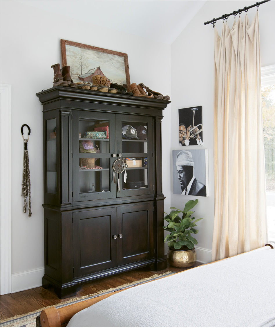 PERSONAL TOUCHES: Portraits of jazz greats Thelonious Monk and Dizzy Gillespie, painted by Jacques himself; above the cabinet is a portrait of a farm once owned by Jacques's family, framed in wood from the very barn that's pictured.