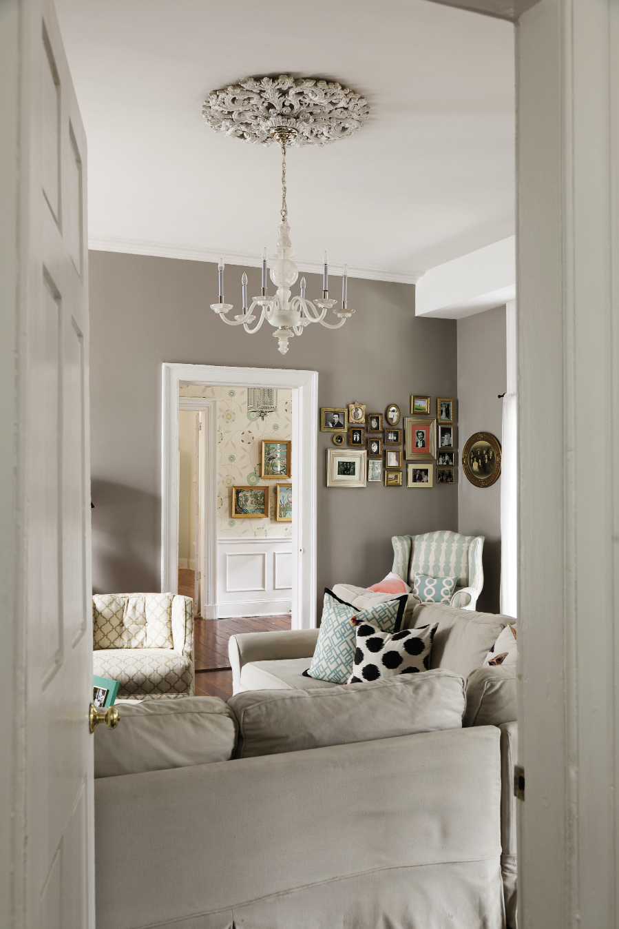 Mixed Mod A cozy mix of a neutral palette, playful patterns, and family-friendly furniture, the Lails' living room is ideal for all generations, including the ancestors featured in the artful framed collage.