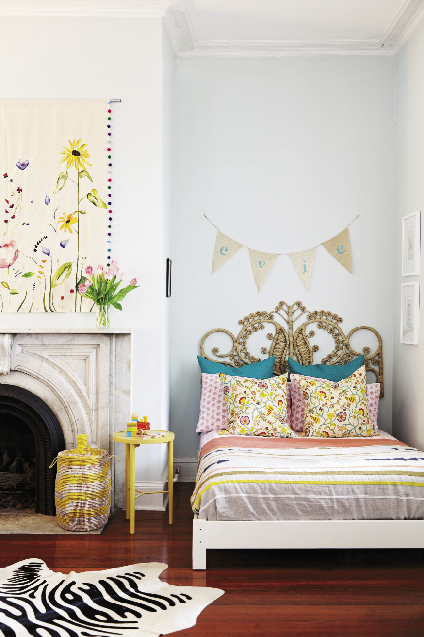 Sweet Dreams Evie's palace is the largest room in the house. Art by Lauren's friend Way Way Allen blooms over the mantel, and Evie originals make another gallery,