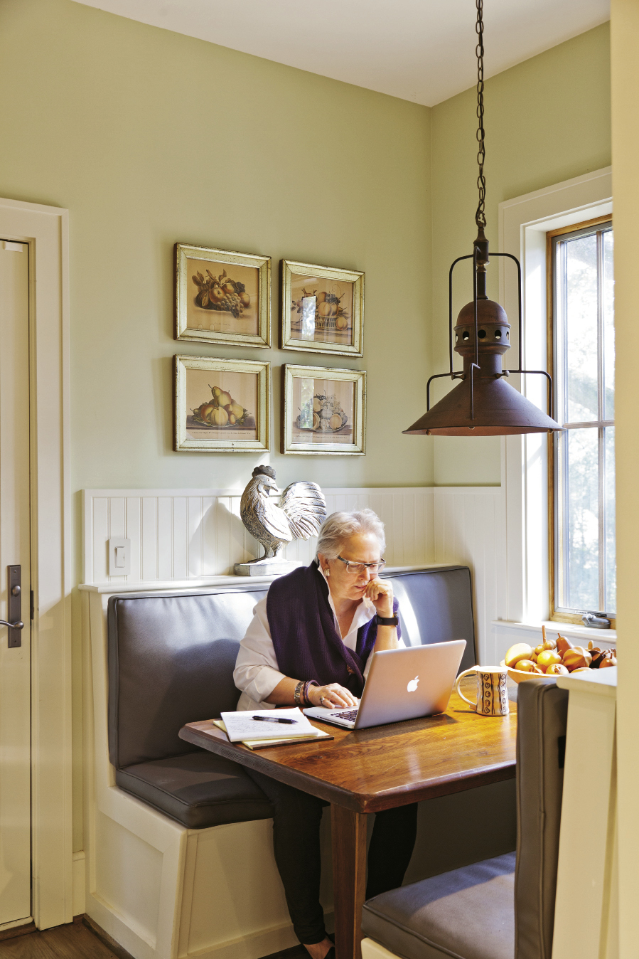Becky Hollingsworth at work in the breakfast nook.