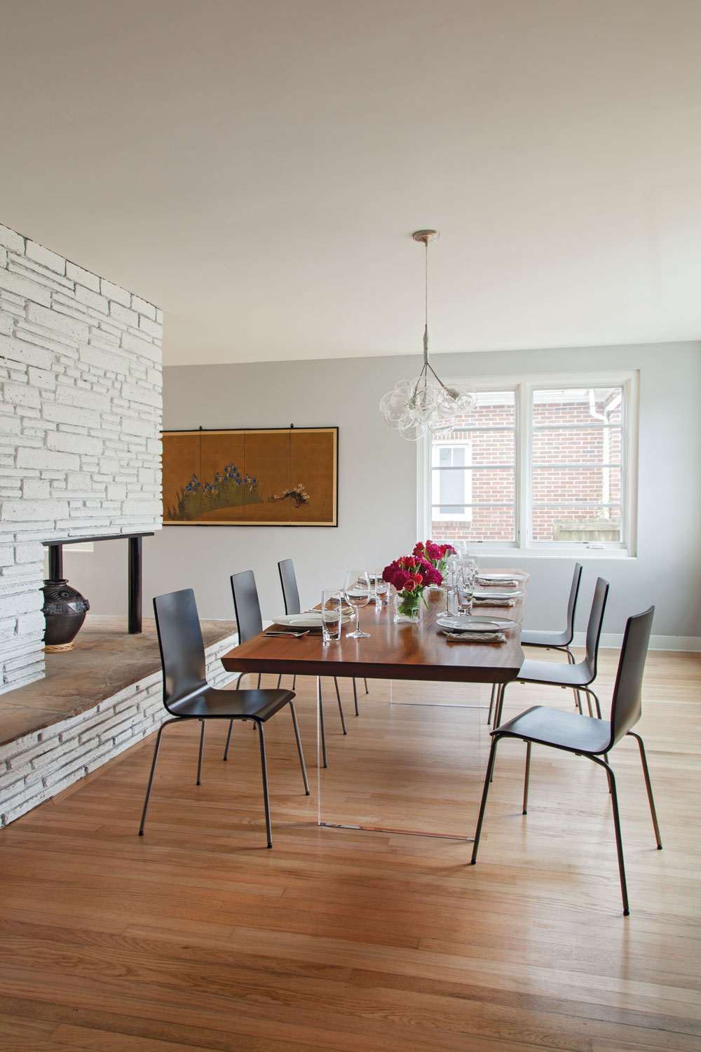 EATING LOCAL: For a sleeker take on the traditional farmhouse table, Bryan Deel of Bryan Deel Timberwerks paired a hardwood top with a pair of Lucite legs.