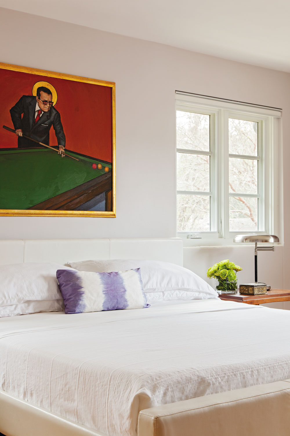 ART WORKS: Christopher is on the board of directors at Redux Studios; his passion for art is reflected in the painting by area artist Bob Snead that hangs in the master bedroom.