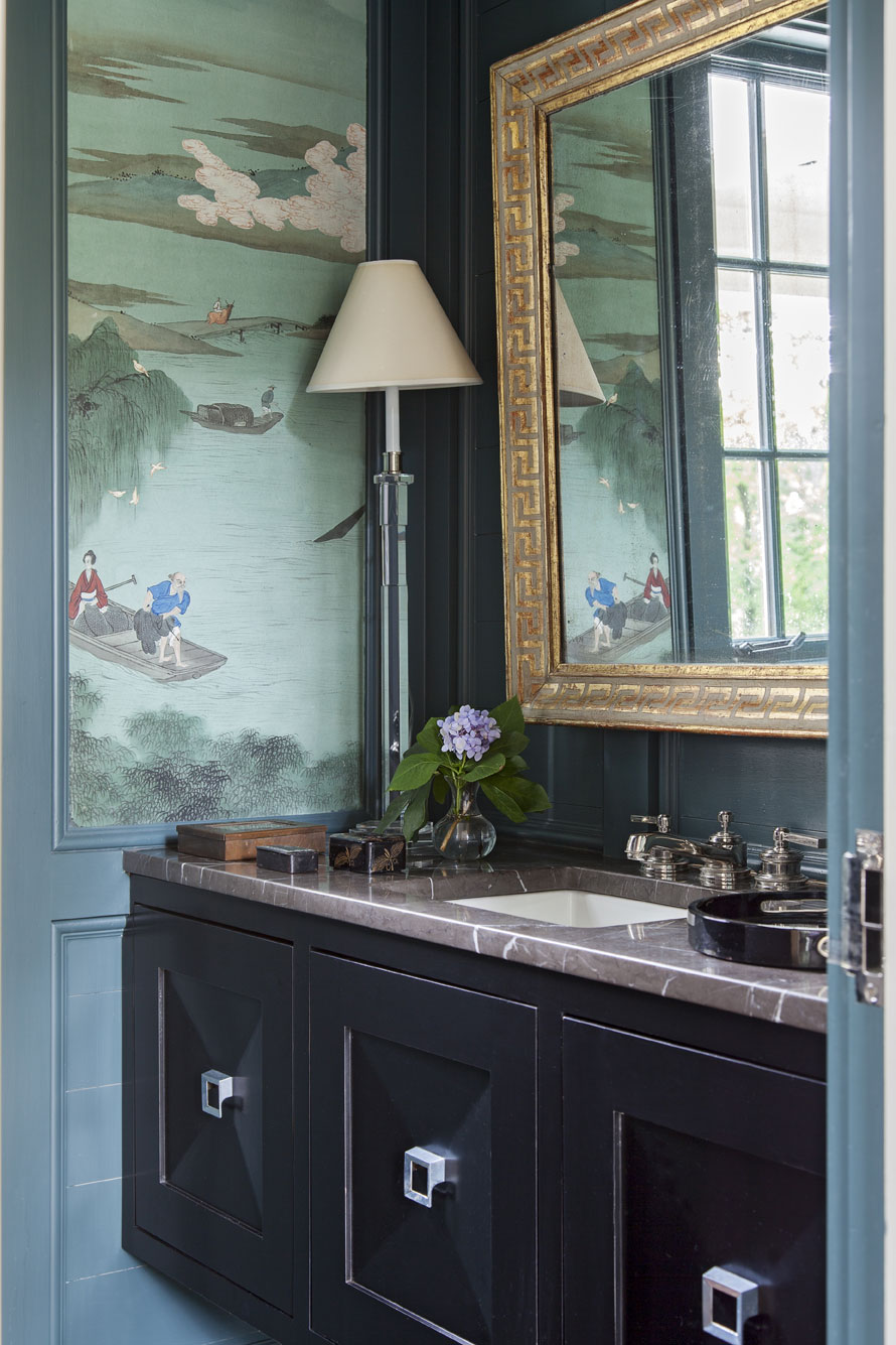 "reinvented: Hand-painted panels that Sarah-Hamlin's grandmother had commissioned during a trip to China find a new home in the first-floor powder room, where they look fresh against walls painted ""Amazon Green"" by Benjamin Moore."