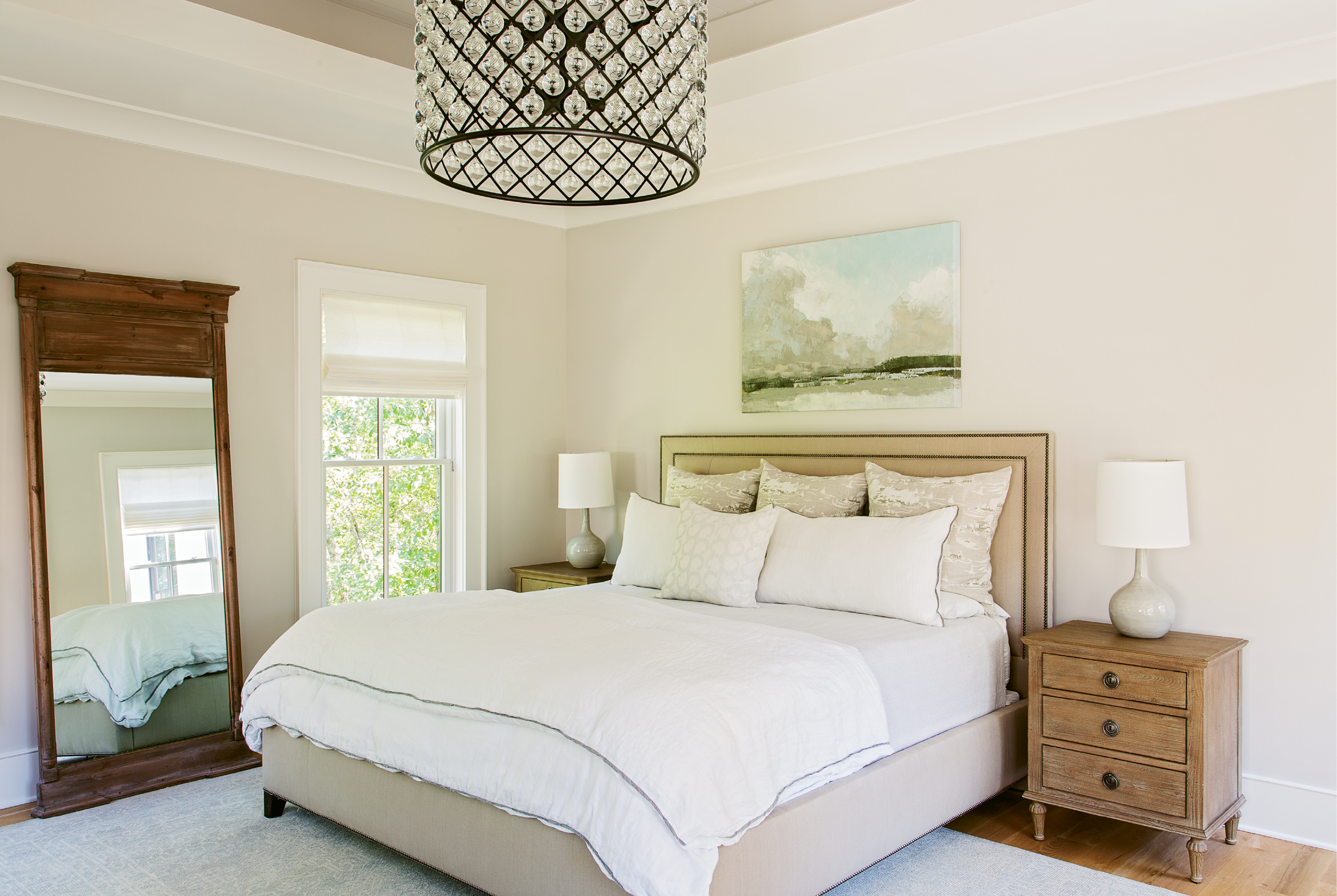 """Dreamy Drama: """"It's my favorite thing in the house,"""" says Theresa of the big, dramatic light fixture in the master bedroom, a constellation of mini-globes reflecting light in dazzling gentleness. """"Keeping the décor neutral and simple allows for going big and making statements with the light fixtures,"""" notes Lenox."""