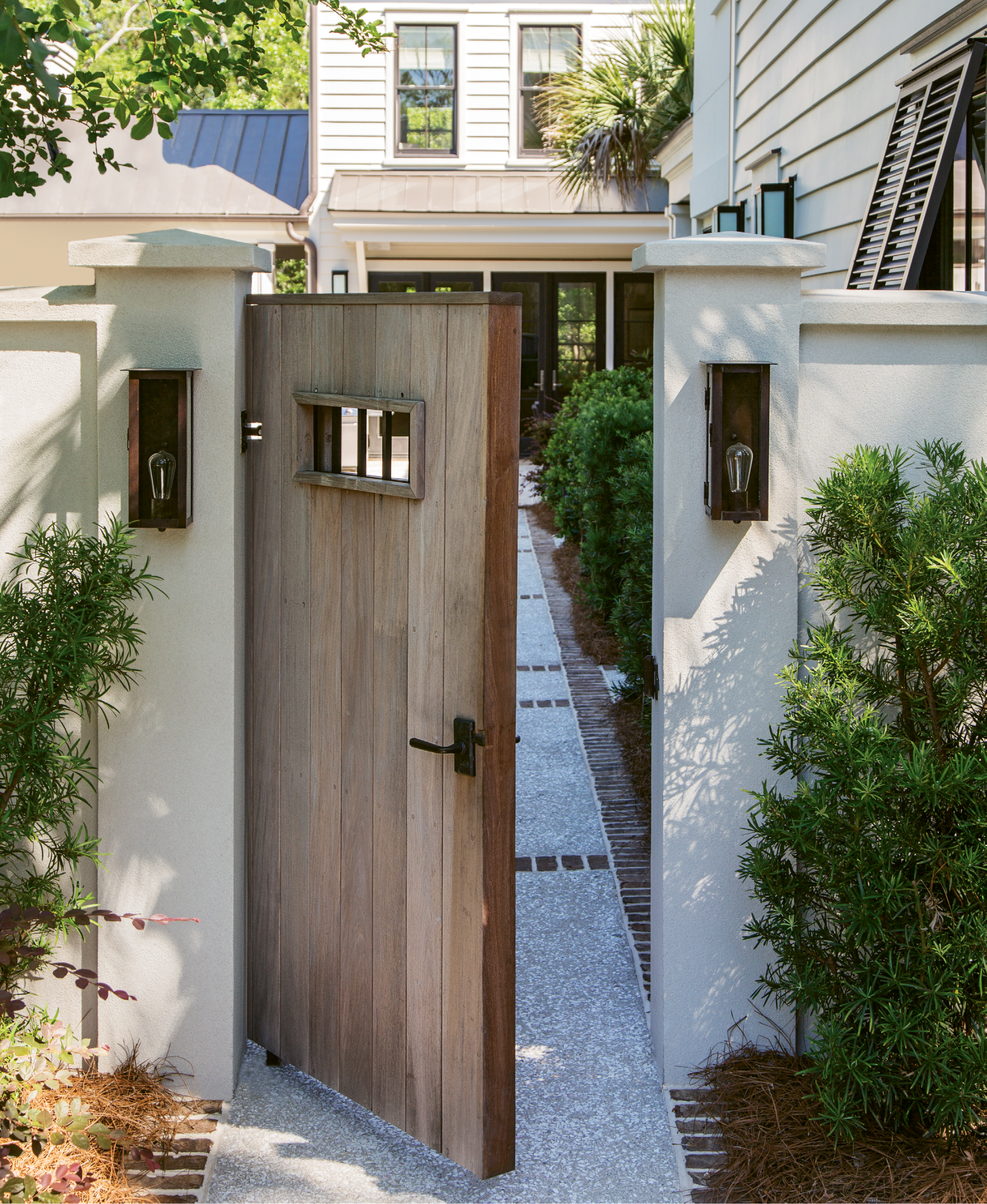 """The custom-made Ipe and iron gate, designed by Melissa Lenox, took some """"serious time to get right,"""" says Theresa. """"We knew it had to make a statement."""""""