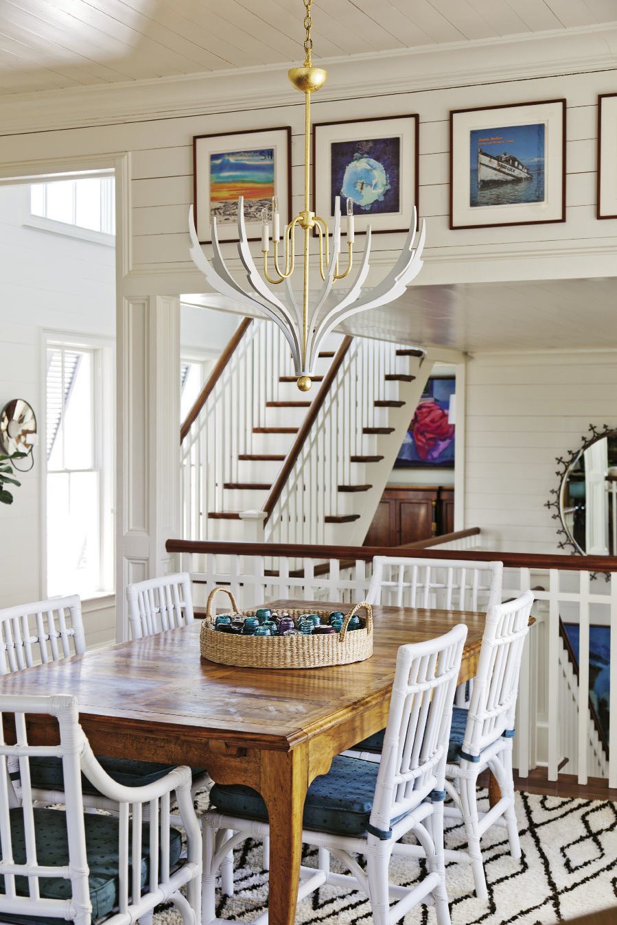 """""""With the upstairs being so open and loft-like, you have to be careful about the weight of the lights,"""" notes Lynne. """"You don't want these heavy, huge masses."""" A sculptural chandelier by local design firm Avrett does the trick, illuminating without interrupting flow."""