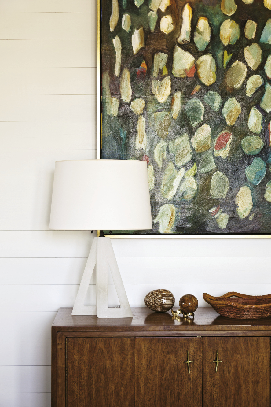 """Before she met Cortney Bishop, Lynne Hamontree was shy about hanging her own works. Now she enjoys being surrounded by her art. This oyster-shell painting, displayed in the upstairs dining area, is perhaps her favorite. """"It's the one painting I'd never sell,"""" she says."""