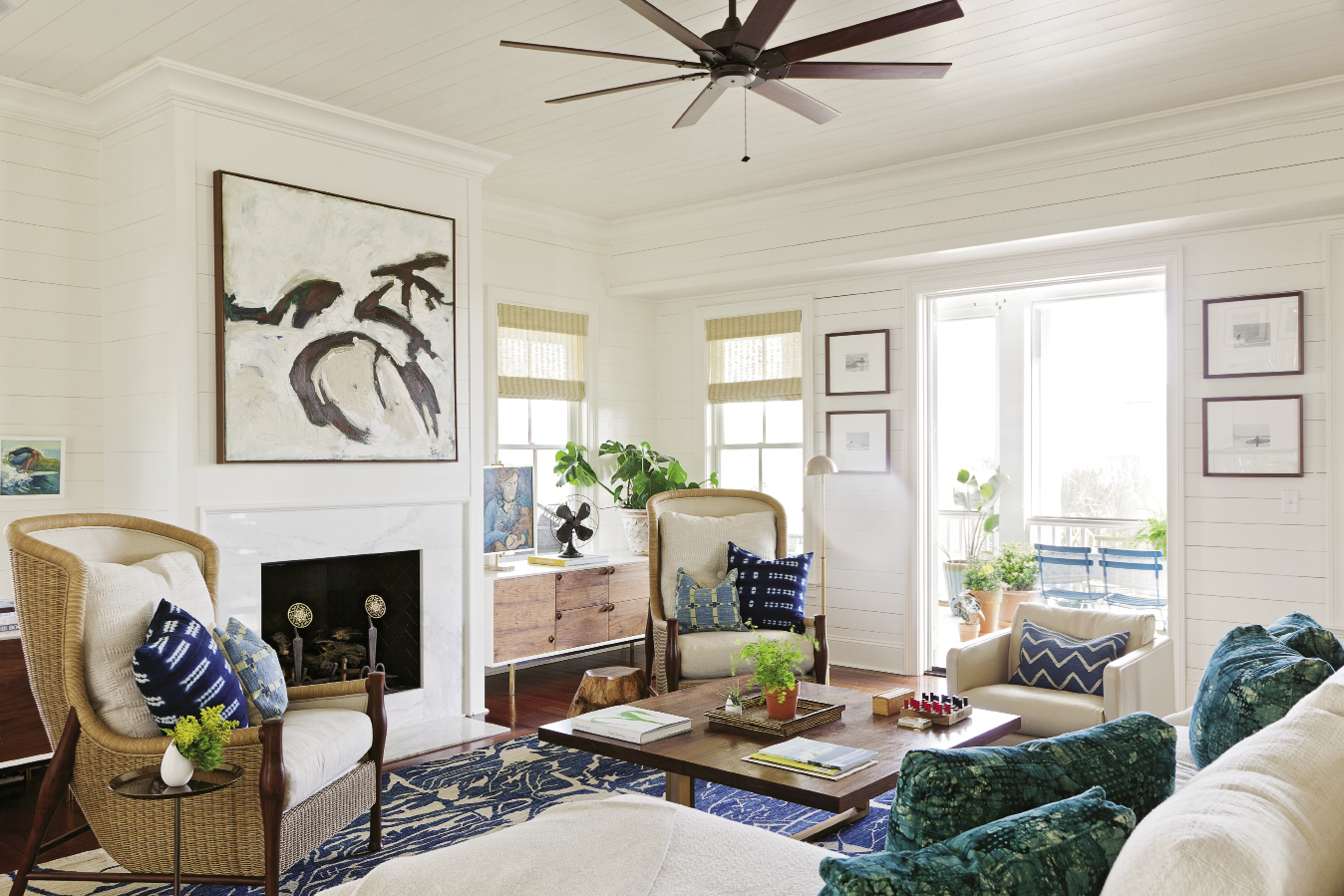 """Lynne was inspired to create the painting above the fireplace after seeing her dog, Jasper, frolicking on the shore. """"She's always running and jumping,"""" she says. """"This is an abstract expression of her movement."""""""