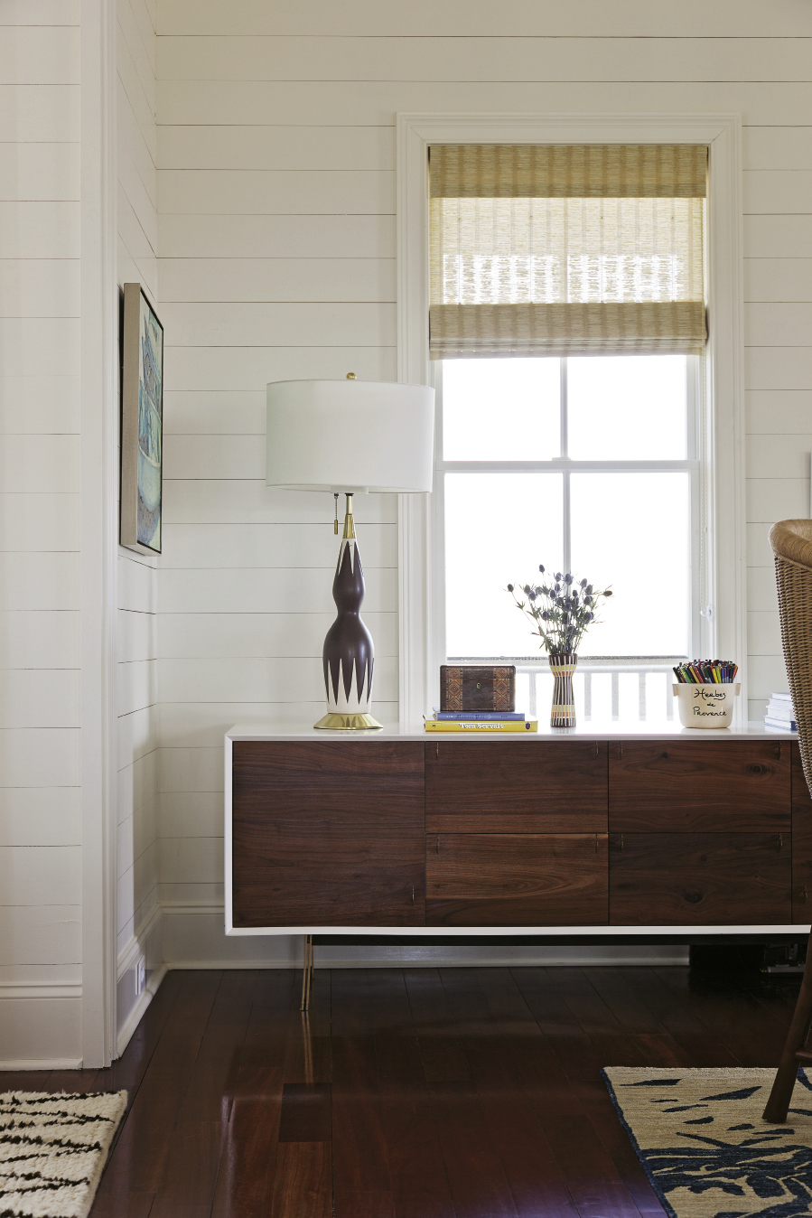 This lamp, purchased on eBay, is one of the couple's favorite pieces in their second-floor living space.