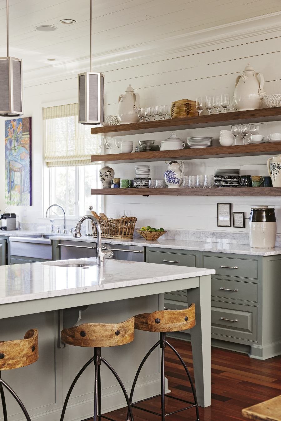Bishop suggested replacing wall-mounted cabinets with open walnut shelving for storage with more warmth and personality.