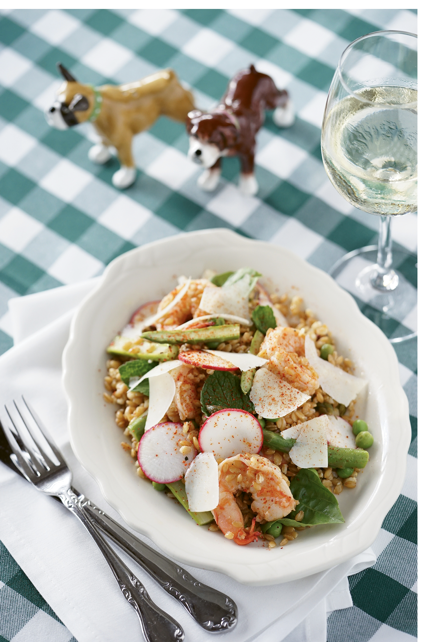 Goodbye, Grits: The shrimp and farro starter nestles fresh radishes, asparagus, peas, and herbs within a hearty serving of the nutty grain.
