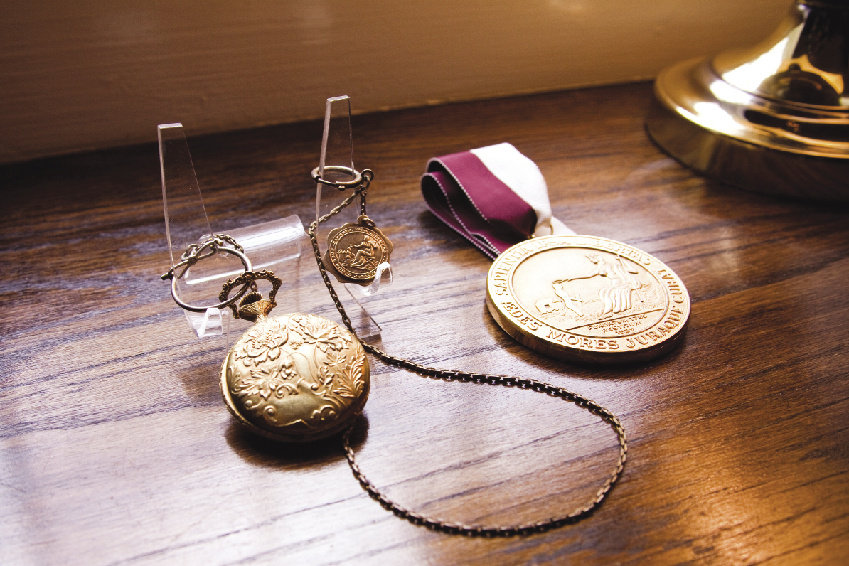 a gold pocket watch, the Bingham Oratorical Medal, and the CofC Founders' Medal (the highest honor given by the institution), which was awarded to him in 1992. Photograph by Caroline Tan