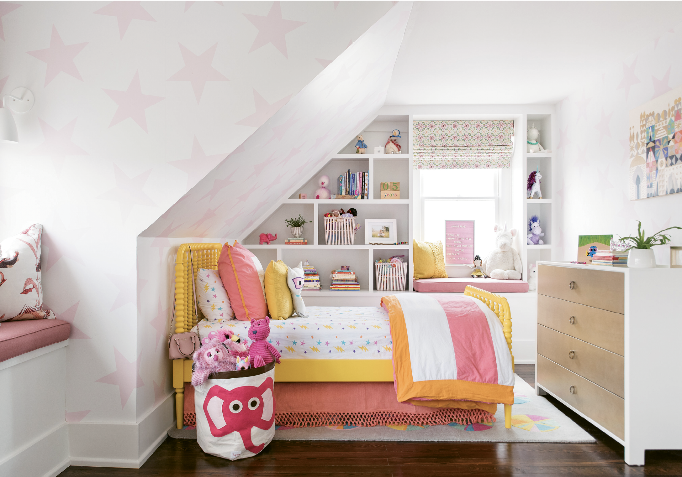 """HAPPY DAYS - The third floor houses Honor and Finn's rooms and their cheerful bath. """"I feel like we did a good job at giving these a magical feeling, a place for them to be little kids,"""" says Parker. Playful wallpaper—Sissy+Marley's """"Lucky Star"""" for her"""