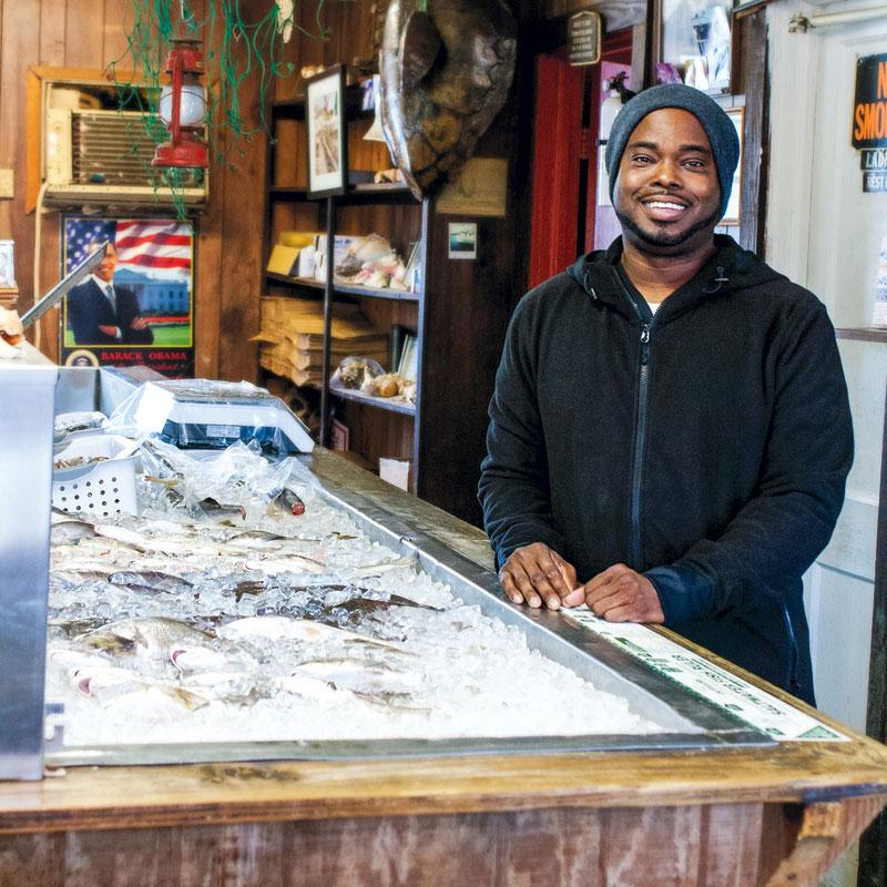 Chef BJ Dennis at his friends' Sol Legare establishment, Backman's Seafood