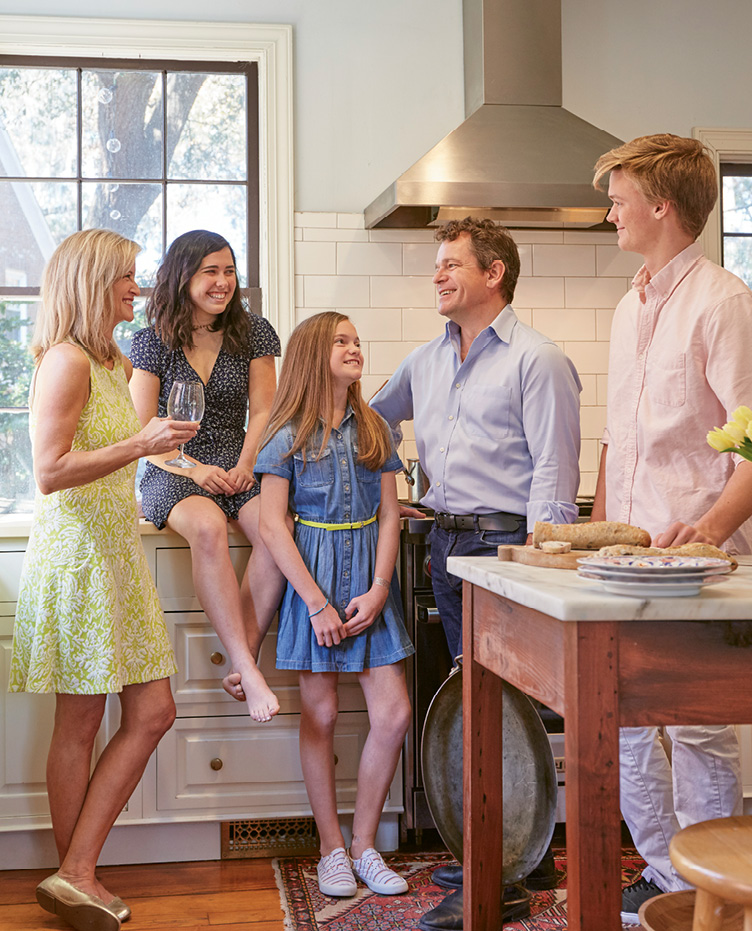 Kids Lily (center) and Luke and friend Sydney join Anne and Patrick in the kitchen.