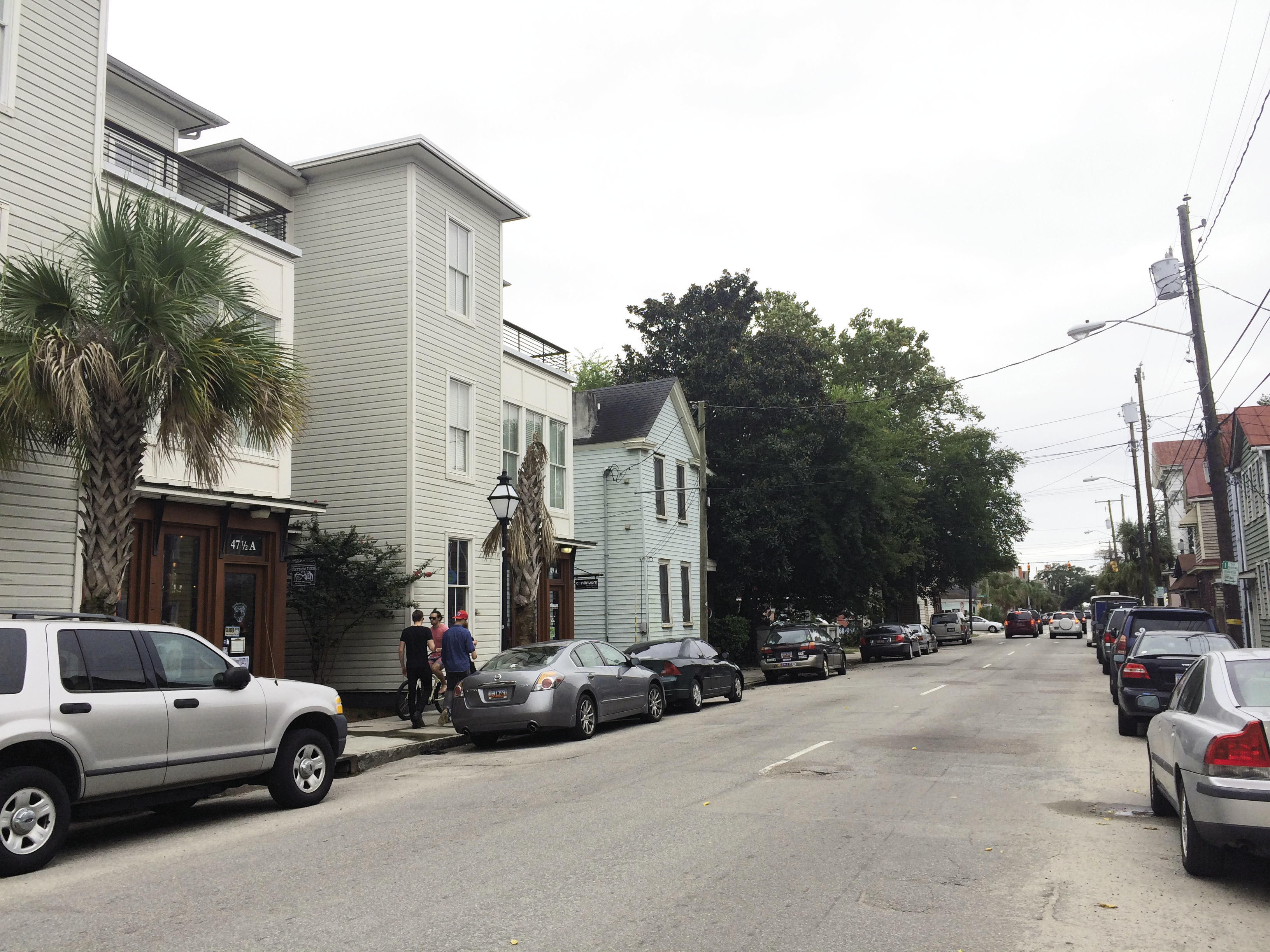 With a growing population on the peninsula, developers are replacing dilapidated housing (as above on Spring Street) with mixed-use buildings, raising gentrification concerns.