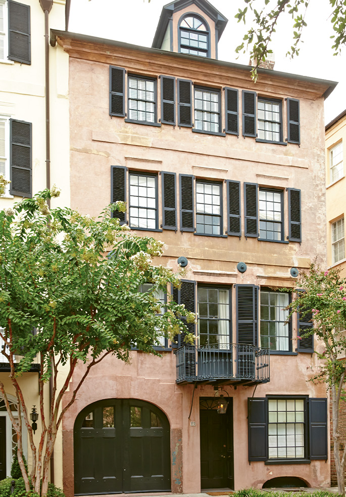 CLASSIC BEAUTY: The Pollaks' townhome on East Bay Street; the façade features a balcony forged by legendary ironworker Philip Simmons.